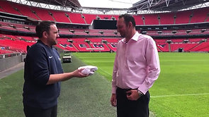 Karl Standley presents Jimmy the Mower with an England Shirt