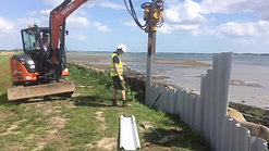 Plastic sheet piling installation on sea-walls, replacing old iron sheet piling.