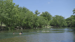 Austin Texas River with People Swimming by Calibrate Films
