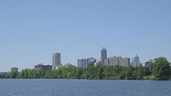 Austin Texas Skyline on Water by Calibrate Films