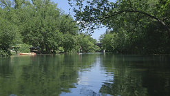 Austin Texas River with Trees by Calibrate Films