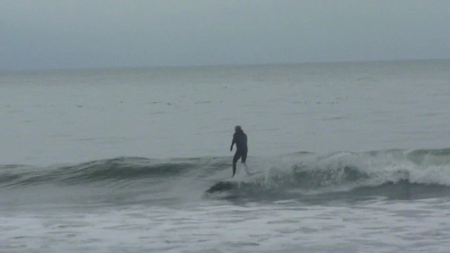 Crazy winter surfers at Jordan River
