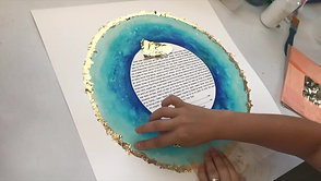 "Applying gold leaf to a ""Lagoon"" Ketubah Print"