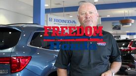 Auto Dealer Promotes Sale