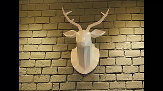 Low poly wooden sculpture of deer trophy head