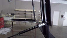 GAS SHOCKS ARE CONCEALED ON A FLIP OUT WINDOW