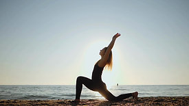 Young woman practicing morning Yoga