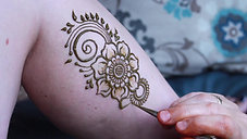 Applying Henna to a leg