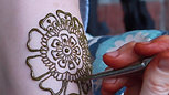 Applying Henna to an Arm