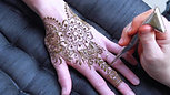 Applying Henna to a hand