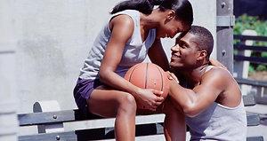 Couple playing basketball hugging rectangle