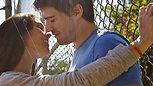 Couple Kissing and playing basketball