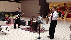 Trio playing Feliz Navidad in a mall in Rochester, NY