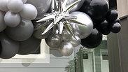 Surprise Birthday Balloon Garland on house