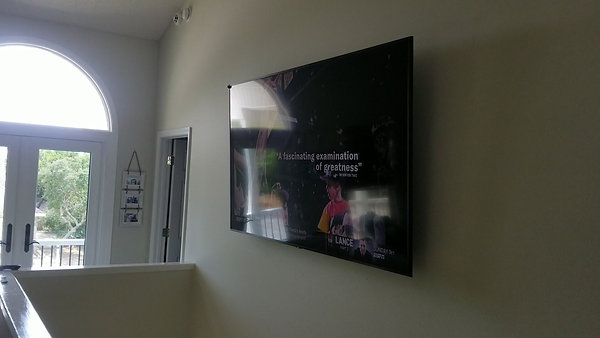 "80""Samsung mounted in 2nd story stairwell"