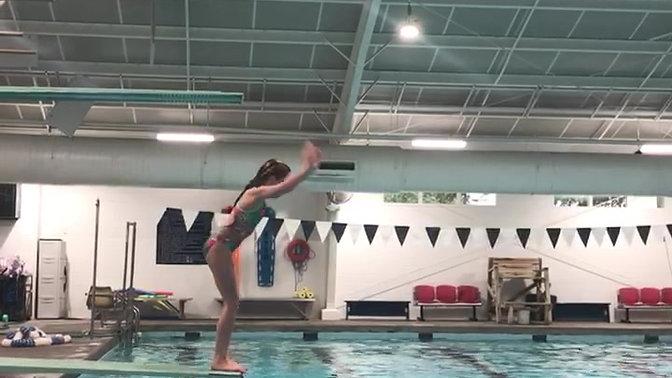 Caroline improving on her front flip