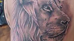Lion and eye tattoo