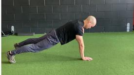 Plank position shoulder taps
