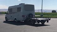 Small Motorhome hauling Freedom Hauler