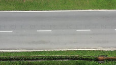Aerial view of a lonely deserted two-lane road.