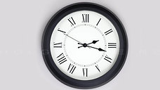 Old-fashioned antiquated wall clock with roman numerals