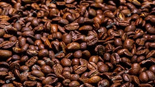Thousands of brown fresh roasted coffee beans