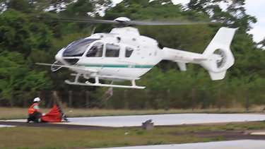 EC-145 Helicopter Landing a Bambi Bucket with a short bridle