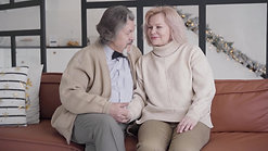 videoblocks-happy-senior-caucasian-couple-sitting-on-couch-on-christmas-eve-and-chatting-portrait-of-charming-old-man-and-woman-resting-on-new-year-at-home-together-eternal-love-holidays-season_rz3geggrp_1080__D