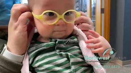 Baby tries glasses on for the first time.