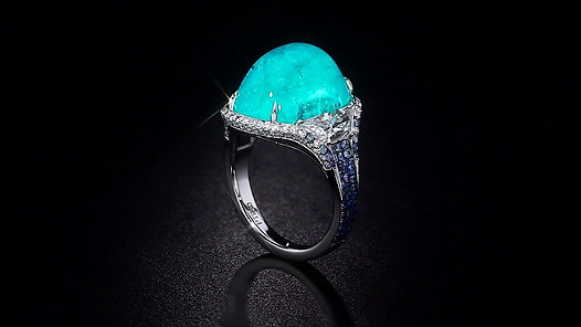 Cabochon Paraiba Tourmaline Ring accented with Sapphires and Diamonds