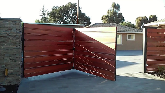 Trackless bi fold automatic gate 14'