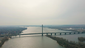 bridge-with-traffic-over-the-river-aerial-drone-fo-QC4EUV7