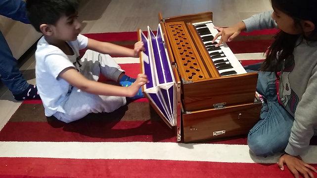 Veer Playing Harmonium