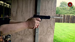 Semi-Automatic long Barrelled Pistol .22 Cal in Slow Motion