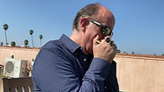 Jim Plays Harmonica at Hotel Normandie Roof