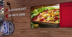 """Experiencia de """"Boston Pizza"""" con la implementación de Señalización Digital"""