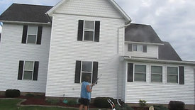Power Washing a House