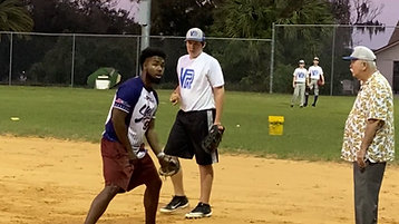 Tagging runner at first base Coach Scheker