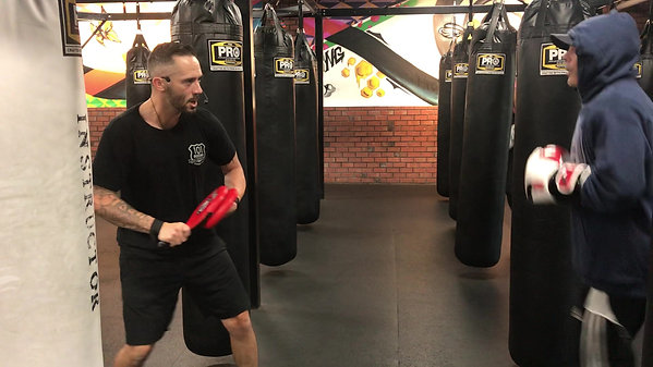 Learn how to hit mitts in a boxing class