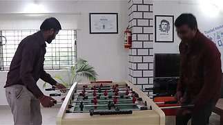 Playing Foosball at Breakout Area