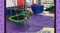 This client must use his motor planning skills to climb across the ninja warrior obstacle course without touching the floor.