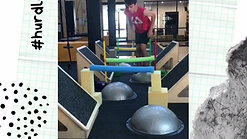 This client is using his vestibular processing skills to jump over the hurdles onto the gym balls on the floor.