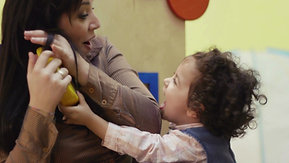 kindergarten-teacher-playing-and-laughing-with-little-young-girl_ekqusf3f__D