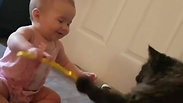 Adorable baby and Cat