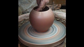 Throwing a rounded vase form