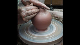 Throwing a small stoneware bottle