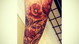 Birthflower arm tattoo