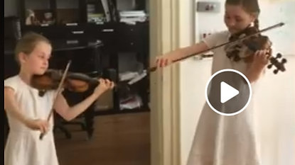 Alma (11) and Helen (8) playing on Mozart's own two violins in his birthplace in Salzburg