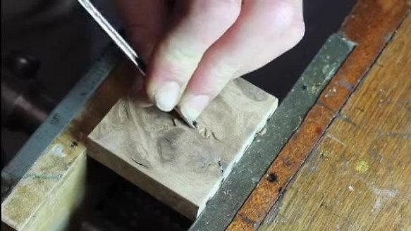 Carving the DK monogram