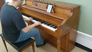 Janssen Piano WIth Lighted Music Desk